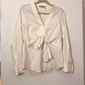 Classic YSL cream button down with knot detail